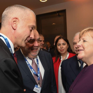 Boris Lozhkin with Angela Merkel